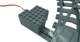 Black and white LEGO monorail track, gray and white LEGO monorail motor cover